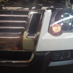 Porsche Panamera Projector Installed into this Ford Explorer Sport